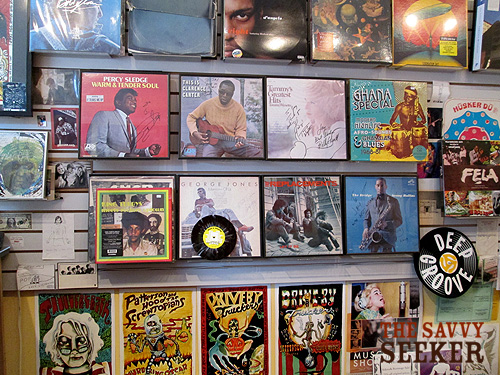 A smattering of autographed records are on display behind the counter.