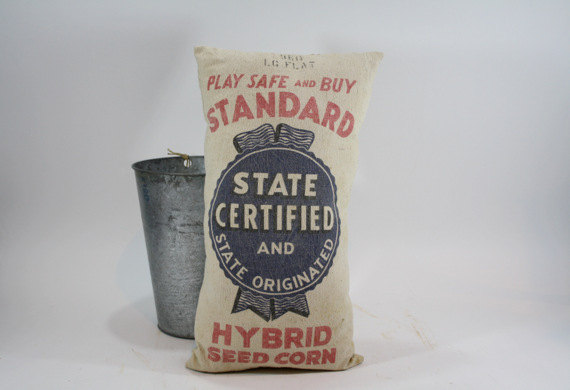 Get cozy with a funky flour sack pillow...galvanized bucket optional:)