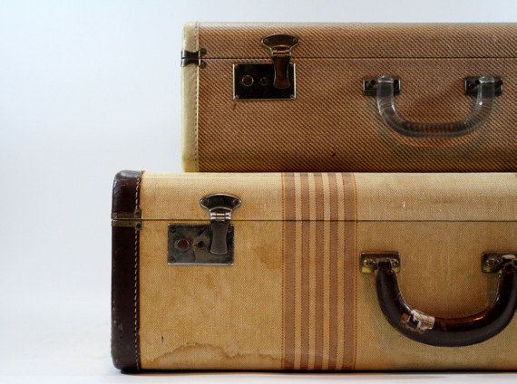 Don't you love these old tweed suitcases? Use them to store your treasures or stack them to make a table!