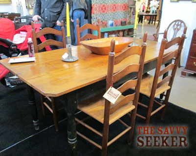 Love this old farm table! Can you spot the Mr. with the stroller in the background?