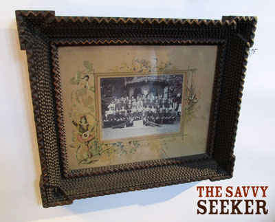 I wonder how many hours went into making this tramp art picture frame (dated 1890-1910)?