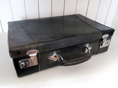 Pack your bags! How about adding this groovy vintage leather suitcase to your home decor?